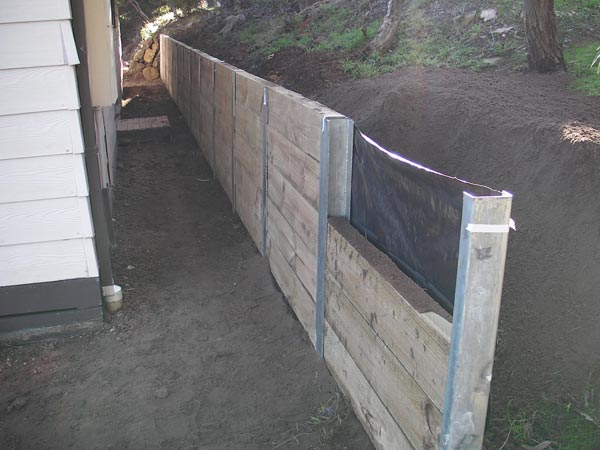 how to build a timber retaining wall with steel posts